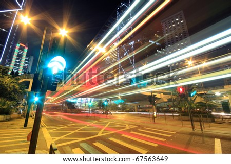 Megacity Highway at night with light trails in hong kong. - stock photo