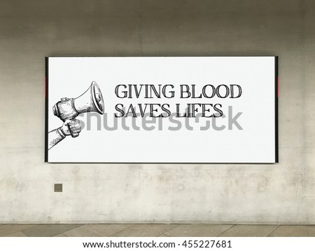 MEGAPHONE ANNOUNCEMENT GIVING BLOOD SAVES LIFES ON BILLBOARD - stock photo