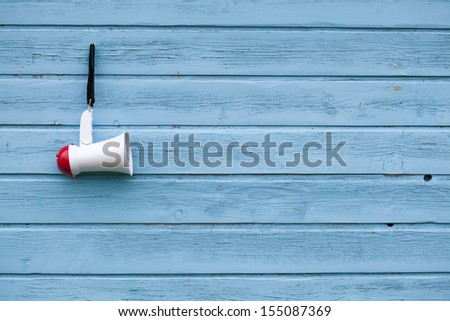 Megaphone on a vintage wooden background - stock photo