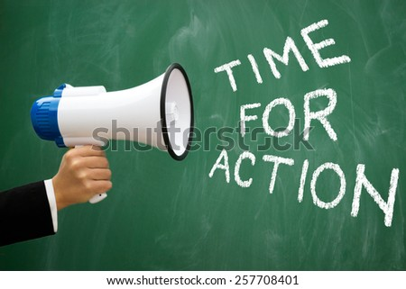 Megaphone with green blackboard with written words: Time for action - stock photo