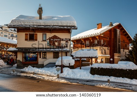 MEGEVE - JAN 10: Village of Megeve on January 10, 2012 in Megeve, France. Megeve with a population of over 4,000 residents is well-known due its popularity as a ski resort. - stock photo