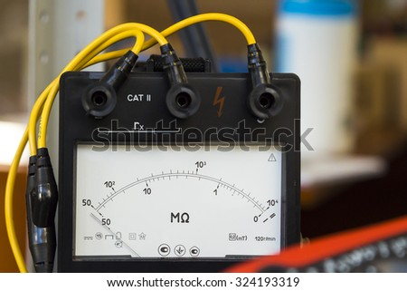 Megger.multimeter. measurement of the voltage in the motherboard - stock photo