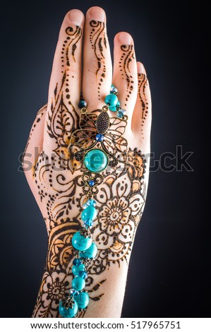 mehendi on hands on a black background