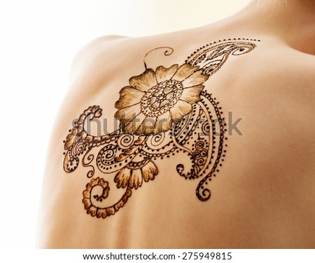 Mehndi. Complex pattern on back of model, close-up - stock photo