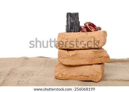 meju (fermented soybean lump) and basic ingredients to make doenjang, isolated on white. - stock photo
