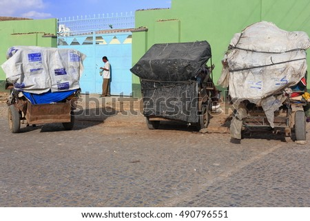 MEKELE, ETHIOPIA-MARCH 29: Local man standing at his home gate looks for his keys inside a plastic bag on March 29, 2013 in Mek'ele-Mekelle town-Tigray region-Ethiopia.