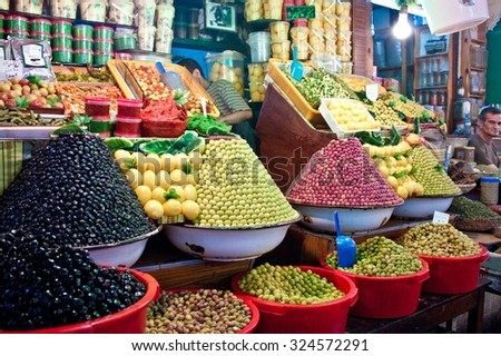 MEKNES, MOROCCO - JUL 28: Olive stall at a market on Jul 28, 2010 in Meknes, Morocco. Meknes is a 1000 years old imperial city in Morocco. - stock photo