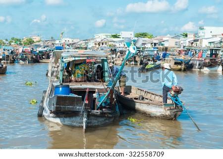 MEKONG DELTA, VIETNAM - April 25, 2014 - Asian floating market on Mekong river in Vietnam - stock photo