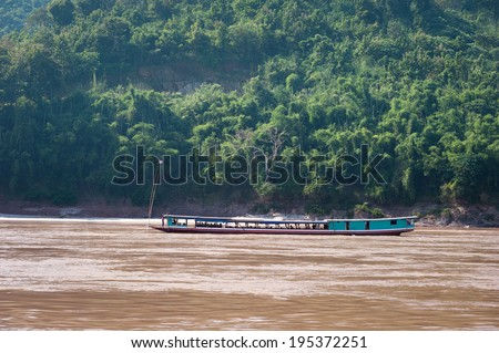 Mekong River Cruise in Laos. Popular tourist adventure trip by slow boat from Huay Xai to Luang Prabang. - stock photo