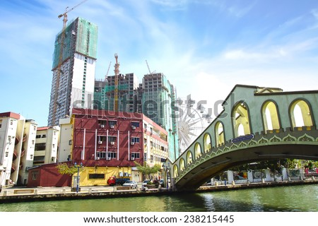 """MELAKA, MALAYSIA - JANUARY 29, 2014: Street art on buildings along the Melaka river. Melacca, dubbed """"Historic State"""", historical city centre has been listed as a UNESCO World Heritage Site.  - stock photo"""