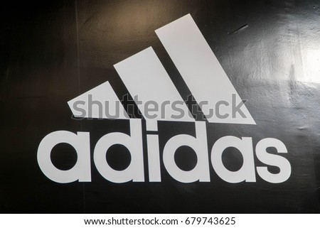 MELAKA, MALAYSIA - JULY 8, 2017: Adidas logo. Adidas is a German multinational corporation, headquartered in Herzogenaurach, Germany, designs and manufactures shoes, clothing and accessories.