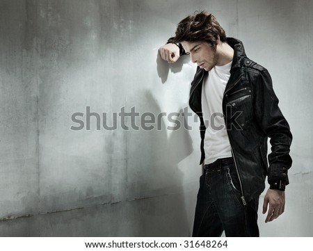 Melancholic guy - stock photo