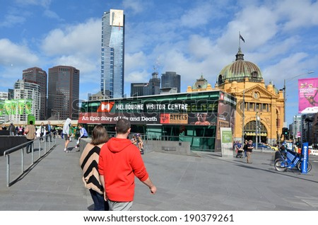MELBOURNE - APR 13 2014:Visitors at the Federation Square.It located at the heart of MelbourneÃ?Â??s CBD with size of an entire city block.It's home to major cultural attractions and world-class events. - stock photo