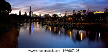 melbourne at dusk looking over the yarra river in the sporting district - stock photo
