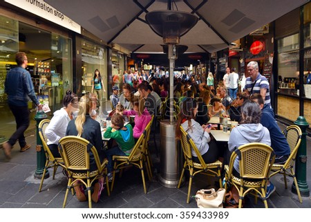 MELBOURNE, AUS - APR 10 2014:Visitors in Degraves Street, one of Melbourne's finest Laneway environments. Full of bars,restaurants, cafe and boutique shopping. - stock photo