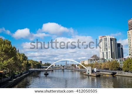 MELBOURNE, AUSTRALIA - APR 12: View of Yarra River and Southgate footbridge on a partly cloudy day on April 12, 2016