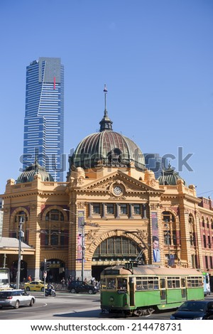 MELBOURNE, AUSTRALIA - AUGUST 28TH, 2014:  Flinders Street Station in Melbourne, Australia. The station is one of the oldest in Australia and is the transport hub within the city of Melbourne.