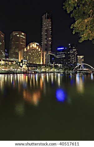 Melbourne Australia, by night.  View over Yarra River towards Southgate, with Eureka Tower in the centre.