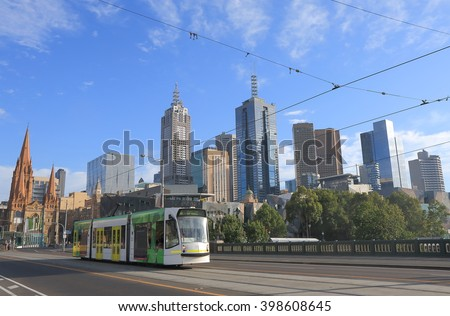 MELBOURNE AUSTRALIA - FEBRUARY 13, 2016: Melbourne cityscape and tram. Melbourne has the largest urban tramway network in the world ahead of St Petersburg.  - stock photo