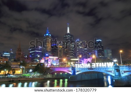 MELBOURNE AUSTRALIA - FEBRUARY 22, 2014: Melbourne's White Night light up attracts locals and tourists - 550,000 people filled Melbourne's streets for annual all-night White Night cultural festival