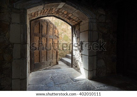 Melbourne, Australia - February 14, 2016: Montsalvat is an artist colony in Eltham on Melbourne's north-eastern outer fringe. This door leads out of the lower level of the Great Hall.