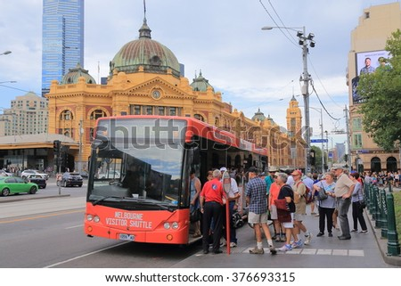 MELBOURNE AUSTRALIA - FEBRUARY 13, 2016:Unidentified people get on Melbourne tourist bus in downtown Melbourne.  - stock photo
