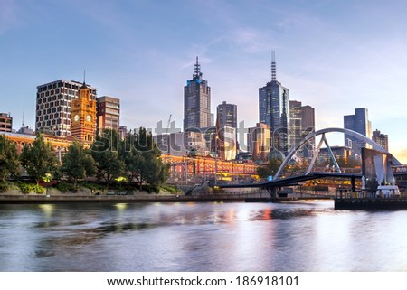 Melbourne, Australia, in early morning light.  Yarra River, towards Flinders Street Station. - stock photo