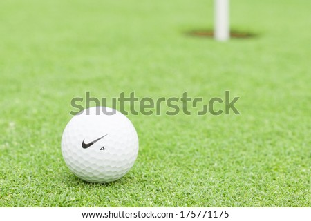 MELBOURNE, AUSTRALIA - JANUARY 18 2014: A Nike golf ball on a green with the hole in the background