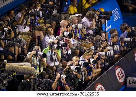 MELBOURNE, AUSTRALIA - JANUARY 30: Australian Open Men's Final, some of the photographers shooting Andy Murray(GBR)[5] get beaten by Novak Djokovic(SRB)[3] on January 30, 2011 in Melbourne, Australia - stock photo