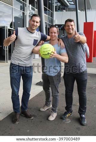 MELBOURNE, AUSTRALIA - JANUARY 23, 2016: Australian tennis fans with autographed tennis ball during Australian Open 2016 at Australian tennis center in Melbourne Park - stock photo