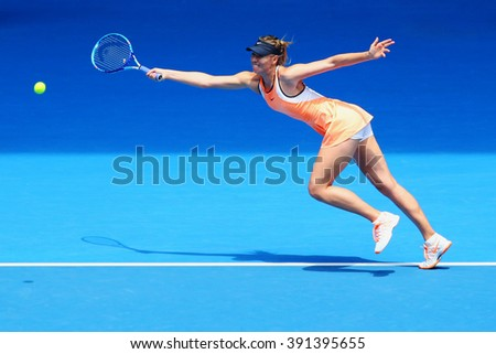 MELBOURNE, AUSTRALIA - JANUARY 26, 2016: Five times Grand Slam champion Maria Sharapova of Russia in action during quarterfinal match against Serena Williams at Australian Open 2016 at Rod Laver Arena - stock photo