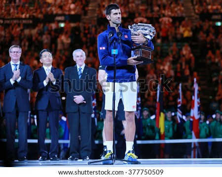 MELBOURNE, AUSTRALIA - JANUARY 31, 2016: Grand Slam champion Novak Djokovic of Sebia holding Australian Open trophy during trophy presentation after victory at Australian Open 2016 in Melbourne Park - stock photo