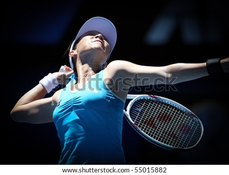 MELBOURNE, AUSTRALIA - JANUARY 26: Jie Zheng in action at her quarter final win over Maria Kirilenko during the 2010 Australian Open on January 26, 2010 in Melbourne, Australia - stock photo