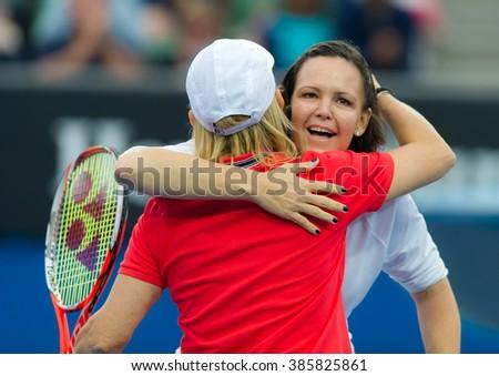 MELBOURNE, AUSTRALIA - JANUARY 25 : Lindsay Davenport and Martina Navratilova celebrate winning their legends doubles match at the 2016 Australian Open - stock photo