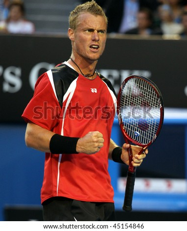 MELBOURNE, AUSTRALIA - JANUARY 23: Lleyton Hewitt in his third round match at the 2010 Australian Open on January 23, 2010 in Melbourne, Australia - stock photo