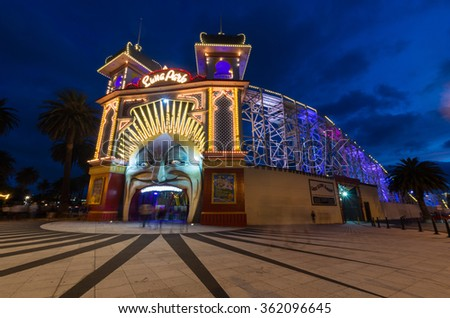 Melbourne, Australia - January 7, 2016: Luna Park in St Kilda is an iconic amusement park that opened in 1912. The entrance is a giant face, seen here after sunset. - stock photo