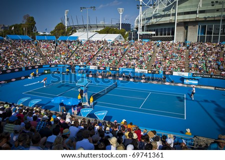 MELBOURNE, AUSTRALIA - JANUARY 22: Margaret Court Arena, Melbourne Cricket Ground Stadium in background & Rod Laver Arena with center court at Australian Open, January 22, 2011 in Melbourne, Australia - stock photo