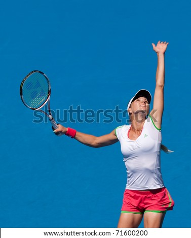 MELBOURNE, AUSTRALIA - JANUARY 28: Maria Kirilenko of Russia plays in the women's doubles final at the Australian Open on January 28, 2011 in Melbourne, Australia