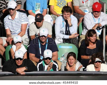MELBOURNE, AUSTRALIA - JANUARY 27: Mirka Federer (2nd R) watches her husband Roger Federer against Nikolay Davydenko in the 2010 Australian Open on January 27, 2010 in Melbourne, Australia - stock photo