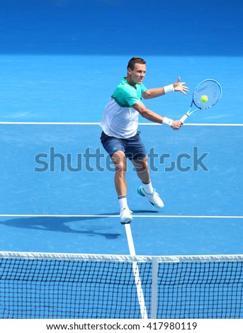 MELBOURNE, AUSTRALIA - JANUARY 26, 2016: Professional tennis player Tomas Berdych of Czech Republic in action during his quarterfinal match at Australian Open 2016 in Melbourne Park