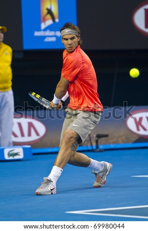 MELBOURNE, AUSTRALIA - JANUARY 26: Rafael Nadal(ESP)[1] is defeated by David Ferrer(ESP)[7] at the Australian Open on January 26, 2011 in Melbourne, Australia - stock photo