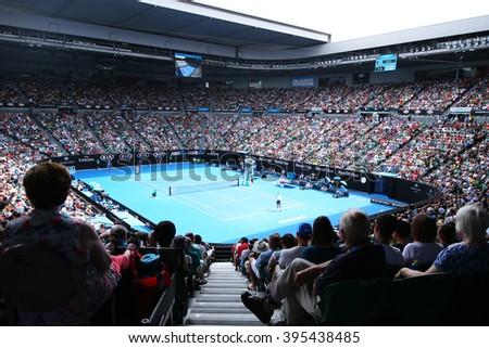 MELBOURNE, AUSTRALIA - JANUARY 28, 2016: Rod Laver arena during Australian Open 2016 match at Australian tennis center in Melbourne Park. It is the main venue for the Australian Open since 1988  - stock photo