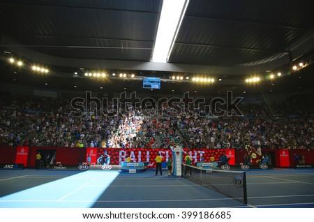 MELBOURNE, AUSTRALIA - JANUARY 23, 2016: Rod Laver arena during Australian Open 2016 match at Australian tennis center in Melbourne Park. It is the main venue for the Australian Open since 1988  - stock photo