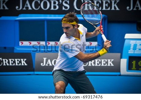 MELBOURNE, AUSTRALIA - JANUARY 17:  Roger Federer(SUI)[2] defeats Lukas Lacko(SVK) at the 2011 Australian Open on January 17, 2011 in Melbourne, Australia - stock photo