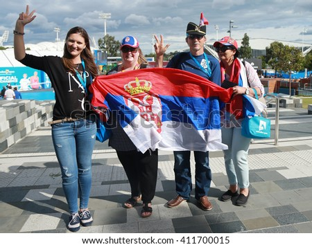 MELBOURNE, AUSTRALIA - JANUARY 31, 2016: Serbian tennis fans with flags at Australian Open 2016 at Australian tennis center in Melbourne Park - stock photo
