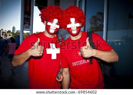 MELBOURNE, AUSTRALIA - JANUARY 23: Swiss fans get ready to watch Roger Federer(SUI)[2] defeat Tommy Robredo(ESP) at the Australian Open on January 23, 2011 in Melbourne, Australia - stock photo