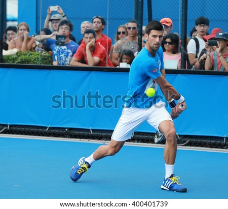 MELBOURNE, AUSTRALIA - JANUARY 27, 2016: Ten times Grand Slam champion Novak Djokovic of Serbia practices for Australian Open 2016 at Australian tennis center in Melbourne Park - stock photo