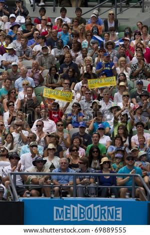 MELBOURNE, AUSTRALIA - JANUARY 26: The crowd watching Andy Murray(GBR)[5] and Alexandr Dolgopolov(UKR) on center court at the Australian Open on January 26, 2011 in Melbourne, Australia - stock photo