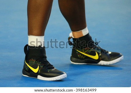 MELBOURNE, AUSTRALIA - JANUARY 30, 2016: Twenty one times Grand Slam champion Serena Williams  wears custom Nike tennis shoes  during her final match at Australian Open 2016 in Melbourne Park - stock photo