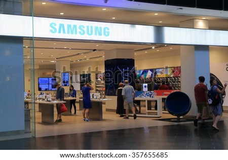 MELBOURNE AUSTRALIA - JANUARY 01, 2016: Unidentified people visit Samsung store. Samsung is a South Korean multinational conglomerate company headquartered in Seoul.  - stock photo